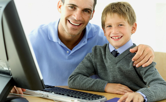 Father and son happy after PC repair at Ant Race.